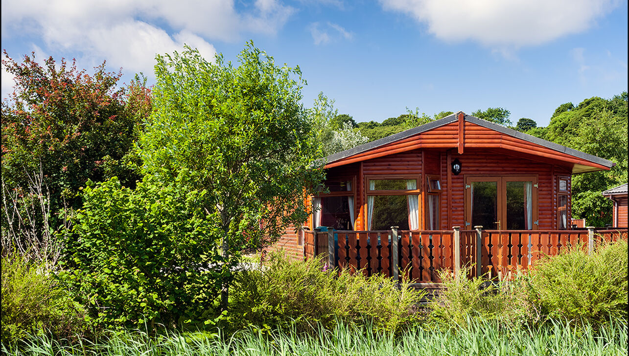 luxury lodges by the river at  River Valley Country Park
